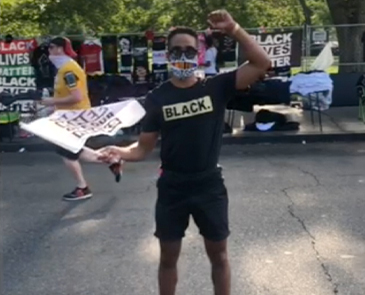 Studio Theatre commissioned seven Black artists to share creative responses to the 2020 March on Washington. Depicted is Jonathan Burke (Studio's production of Choir Boy). Still photo from video provided by the artist